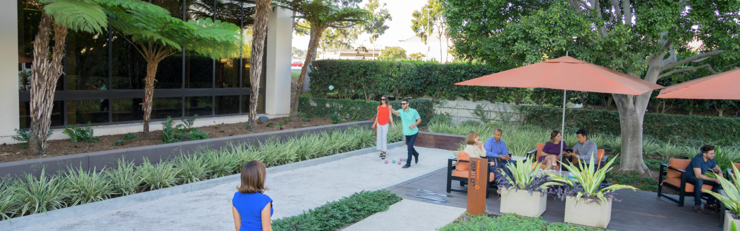 Photography of people enjoying The Commons, an outdoor workplace and gathering area, at La Jolla Gateway in San Diego, CA