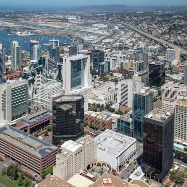 Aerial photography of downtown San Diego featuring 225 Broadway, 101 West Broadway, One America Plaza and 501 West Broadway in San Diego, CA